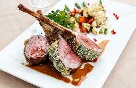 Rack of lamb with citrus-port sauce, oven-roasted vegetables, and bacon-leek potato gratin at Anton and Michel in Carmel, Calif., Saturday, November 14, 2015.