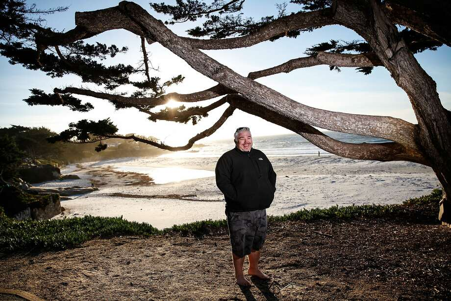 Chef Todd Fisher at Carmel Beach, his favorite for strolling with his wife, Ada, and dog, Alfred. Photo: Sarah Rice, Special To The Chronicle