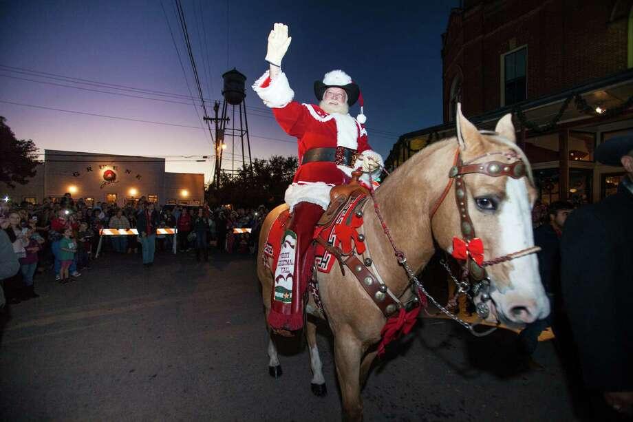 Parades, holiday lights, visits with Santa spread holiday cheer ...