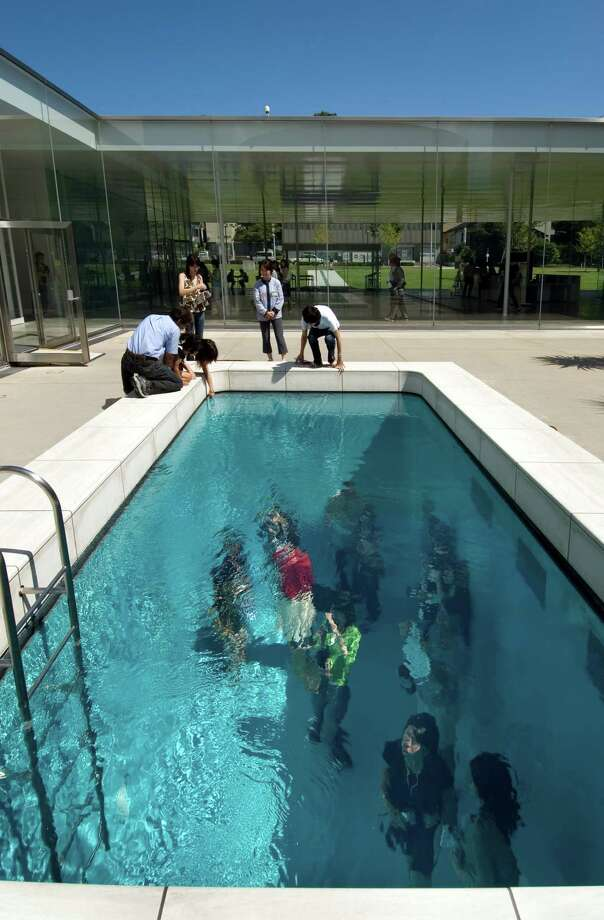 This art installation, an empty swimming pool topped by a layer of water about 10 centimeters deep suspended over glass, is at the 21st Century Museum of Contemporary Art in Kanazawa, Japan. Photo: Japan National Tourism / ONLINE_YES