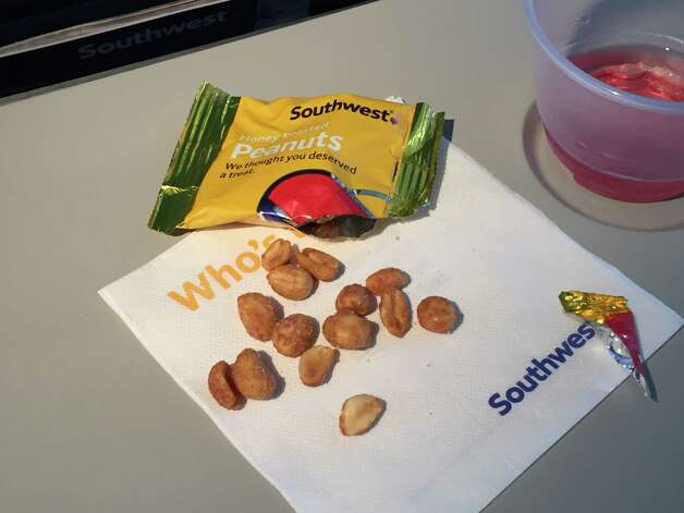 The way we get nickeled and dimed by airlines is an outrage, but not so outrageous that you should throw luggage for being denied free peanuts.Fifteen minutes into a flight from Rome to Chicago, police say a Berkeley man went bananas after his second demand for free nuts and crackers went unfulfilled. The flight was diverted to Belfast when authorities say the man became abusive and assaulted a flight attendant. Even if those nuts were honey-roasted there's no justifying that kind of behavior.  Photo: Brandon M. Mercer