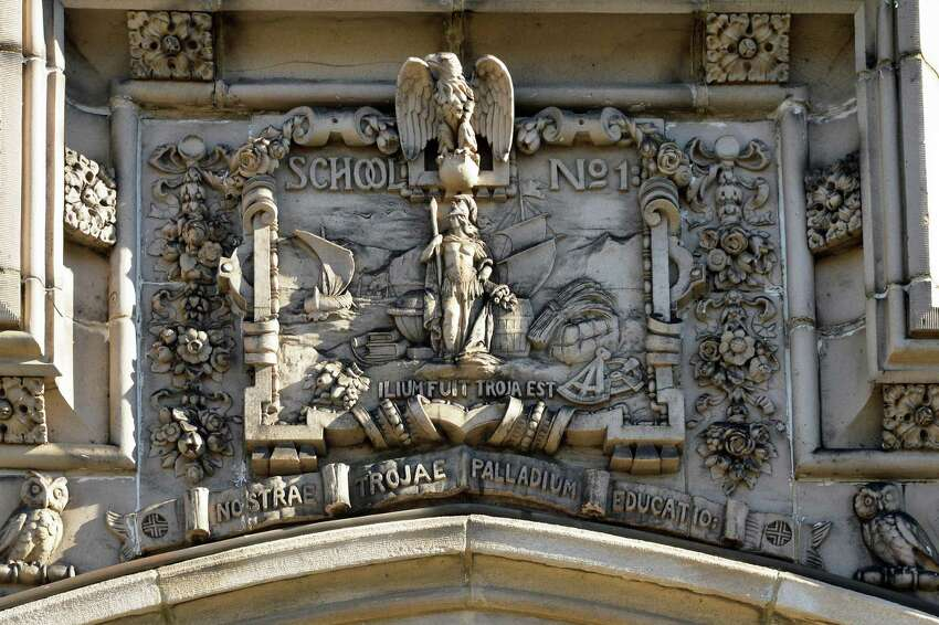 A carving above the main entrance to the former School No. 1, slated to be converted to apartment space Friday Nov. 20, 2015 inTroy, NY. (John Carl D'Annibale / Times Union)
