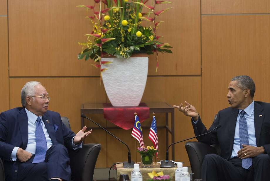 Malaysian Prime Minister Najib Razak (left) and President Obama meet before the start of the 10-nation ASEAN conference in Kuala Lumpur, Malaysia. Photo: Saul Loeb, AFP / Getty Images