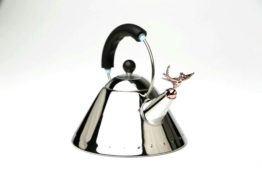 """To celebrate the 30th anniversary of Michael Graves' 1985 tea kettle for Alessi, introducing the Tea Rex. Gravesé¢Ã©""""é´ iconic bird whistle has been redesigned as a supernatural dragon in a copper metallic finish. Tea Rex 9093 tea kettle, $220. Anniversary edition of copper bird and dragon, $80 Thursday, Nov. 12, 2015, in Houston, Texas. ( Gary Coronado / Houston Chronicle ) Photo: Gary Coronado, Staff / © 2015 Houston Chronicle"""