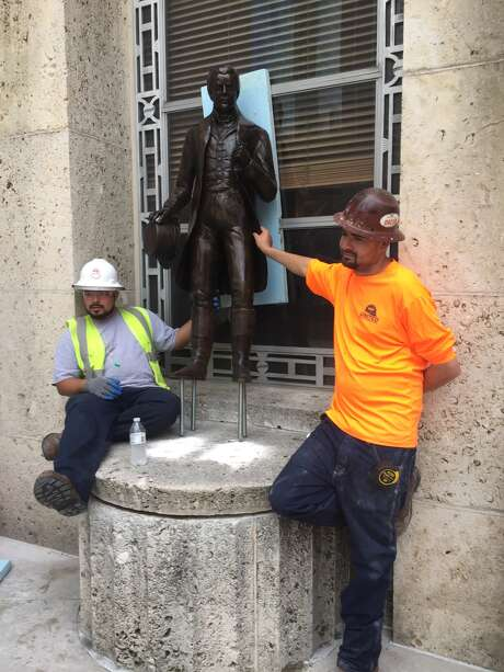 In 2015, workers install statues of the Allen brothers at the entrance to Houston City Hall. The statues are said to be life-size.