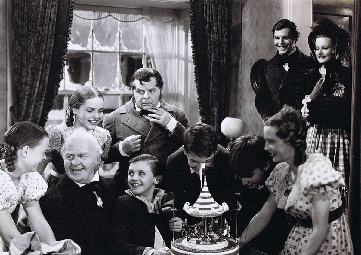 """June Lockhart (left) smiles at Scrooge (Reginald Owen) at the conclusion of """"A Christmas Carol."""""""