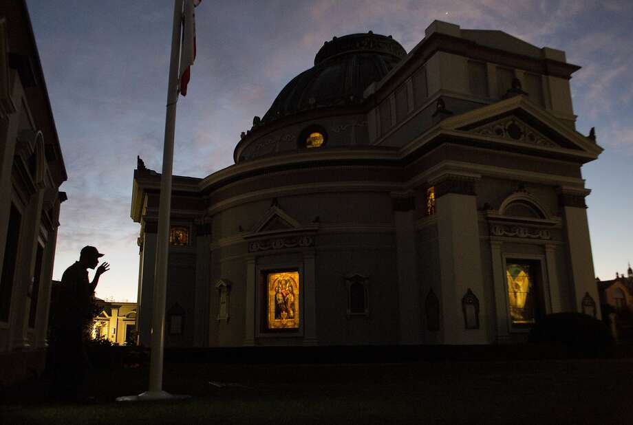 Emmitt Watson raises the flags at the San Francisco Columbarium, where he has been working for 28 years. Photo: Erin Brethauer, The Chronicle
