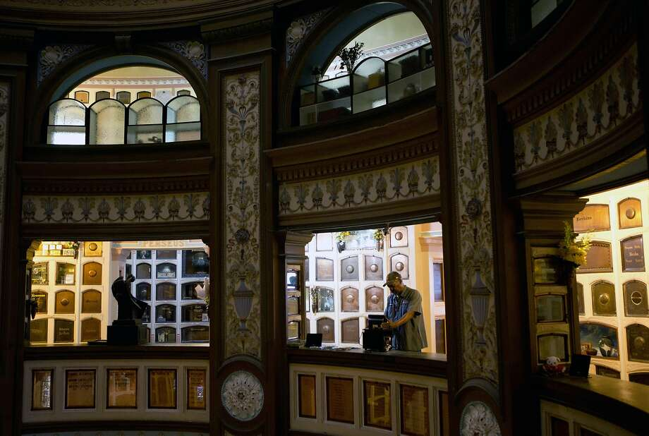 Emmitt Watson turns on some music at the San Francisco Columbarium in the early morning. Photo: Erin Brethauer, The Chronicle