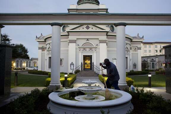 "Emmitt Watson, 59, cleans a water fountain early morning at the San Francisco Columbarium on November 20, 2015 in San Francisco, Calif.   Watson has been working as a groundskeeper, gardener and tour guide at the Columbarium for nearly 28 years. He also leads internments of remains and services. ""This job made me who I am,"" says Watson, who says his favorite part of the job is helping those who are grieving. ""I like making a sad heart smile."""