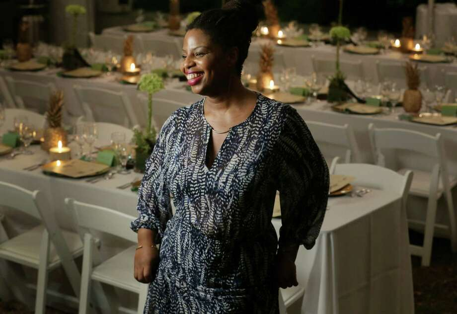 """The artist Zina Saro-Wiwa was in a dancing mood before """"The Mangrove Banquet"""" she staged with foods from the Niger Delta. Photo: Jon Shapley, Staff / © 2015 Houston Chronicle"""