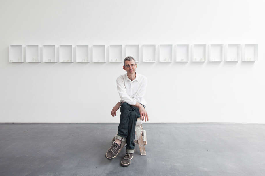 """The author and artist Edmund de Waal is  pictured in front of one of his ceramic installations. His new book, """"The White Road,"""" was released this week. Photo: Ben McKee"""