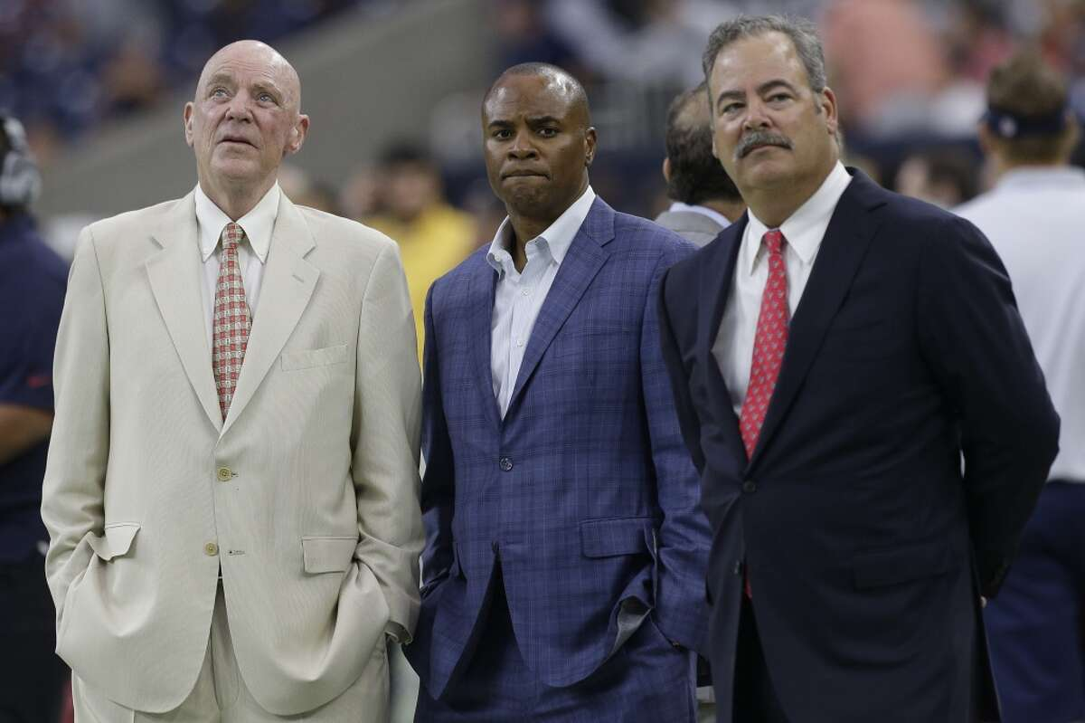 Texans general manager Rick Smith (center) has been a lightning rod for criticism from the team's fans. Click through the gallery to see where Smith ranks in Aaron Wilson's 2015 NFL general manager rankings.