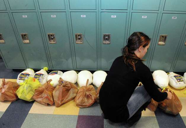 Green Tech High Charter School art teacher Nikki Demagistris fills bags for delivery to community houesholds on Friday Nov. 20, 2015 in Albany, N.Y.  (Michael P. Farrell/Times Union) Photo: Michael P. Farrell / 10034307A