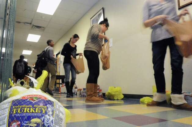Green Tech High Charter School staff and students fills bags for delivery to  community houesholds on Friday Nov. 20, 2015 in Albany, N.Y. (Michael P. Farrell/Times Union) Photo: Michael P. Farrell / 10034307A