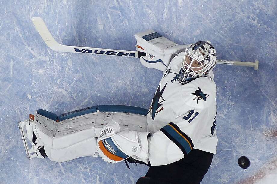San Jose Sharks' Martin Jones watches the puck sail past during the second period of an NHL hockey game against the Philadelphia Flyers, Thursday, Nov. 19, 2015, in Philadelphia. (AP Photo/Matt Slocum) Photo: Matt Slocum, Associated Press