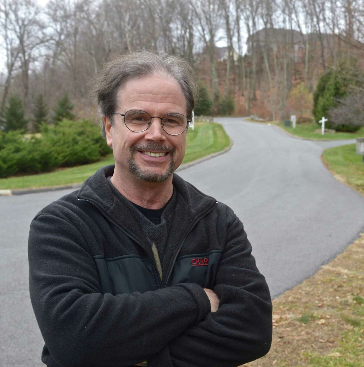 Developer John O'Bine stands at the entrance to the recently completed Park Glen, a 17-unit luxury active adult community in Northville, that he developed with John Delay. Wednesday, November 18, 2015, in New Milford, Conn.