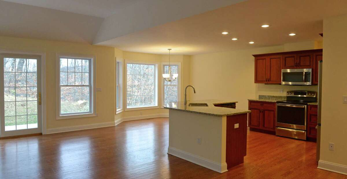 The kitchen/dining room/living room of a town house in the recently completed 17 unit luxury active adult community in Northville, by developers John O'Bine and John Delay. Wednesday, November 18, 2015, in New Milford, Conn.