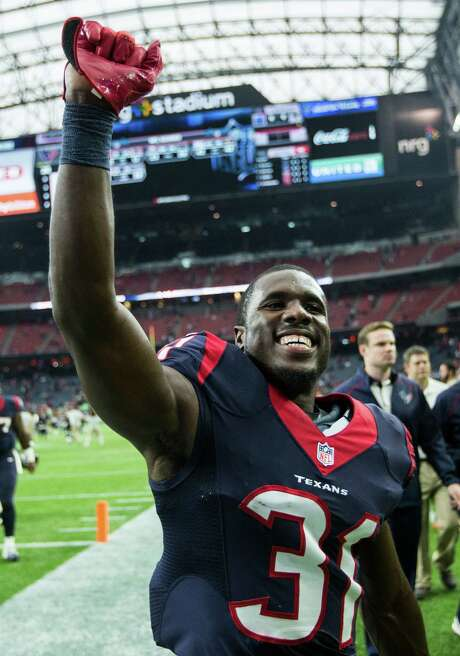 Cornerback Charles James has brought his boundless enthusiasm, megawatt smile, colorful socks and love of football back to the Texans. Photo: Brett Coomer, Staff / © 2015  Houston Chronicle