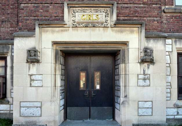 Carvings flank the girl's entrance to the former School No. 1, slated to be converted to apartment space Friday Nov. 20, 2015 inTroy, NY.   (John Carl D'Annibale / Times Union) Photo: John Carl D'Annibale / 10034392A