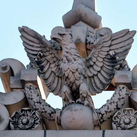 One of the stone eagle carvings atop the former School No. 1, slated to be converted to apartment space Friday Nov. 20, 2015 inTroy, NY.   (John Carl D'Annibale / Times Union Photo: John Carl D'Annibale / 10034392A