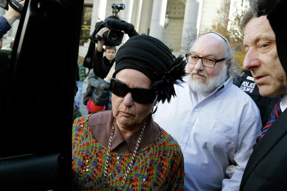 Convicted spy Jonathan Pollard and his wife Esther leave court in New York on Friday.  His attorneys began a court challenge to terms of his parole.  Photo: Mark Lennihan, STF / AP