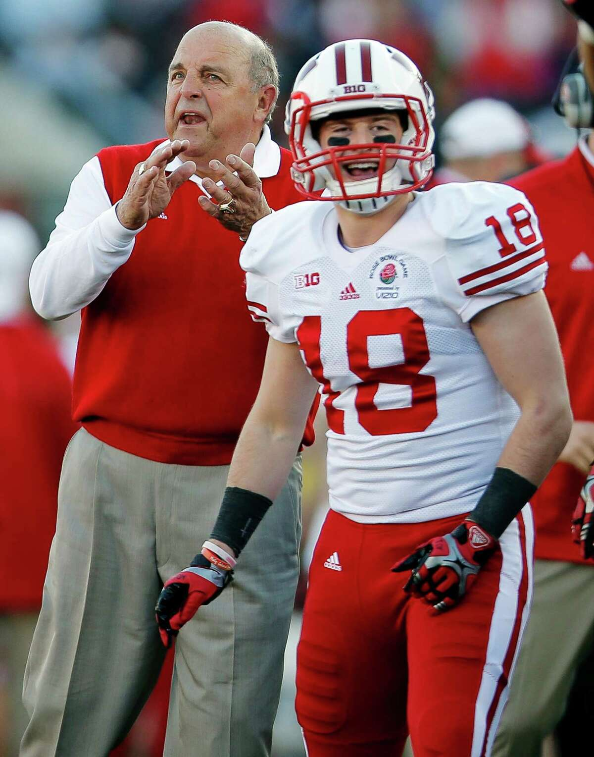 Wisconsin left coach Barry Alvarez and wide receiver Lance Baretz react after a touchdown during the first half of the Rose Bowl against Stanford on Jan. 1, 2013, in Pasadena, Calif.