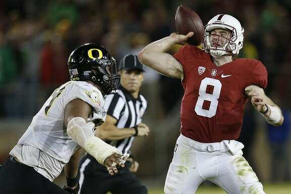 Stanford quarterback Kevin Hogan throws under pressure from Oregon defensive lineman DeForest Buckner (44) during the second half of an NCAA college football game Saturday, Nov. 14, 2015, in Stanford, Calif. Oregon won 38-36. (AP Photo/Tony Avelar)