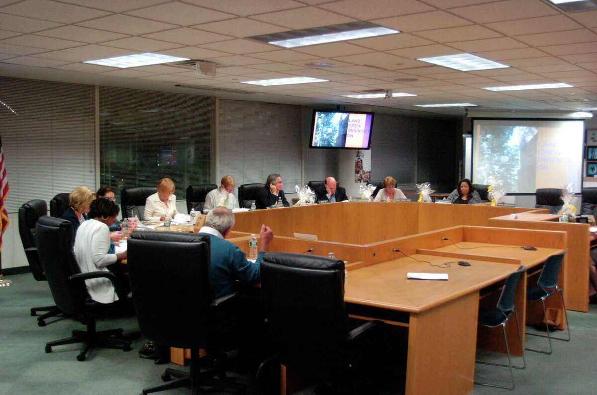 Nine voting members sit at Tuesday night's meeting of the Board of Education. Tuesday marked the first full meeting of the board to include a full compliment of members since July's resignation of Republican John Leydon
