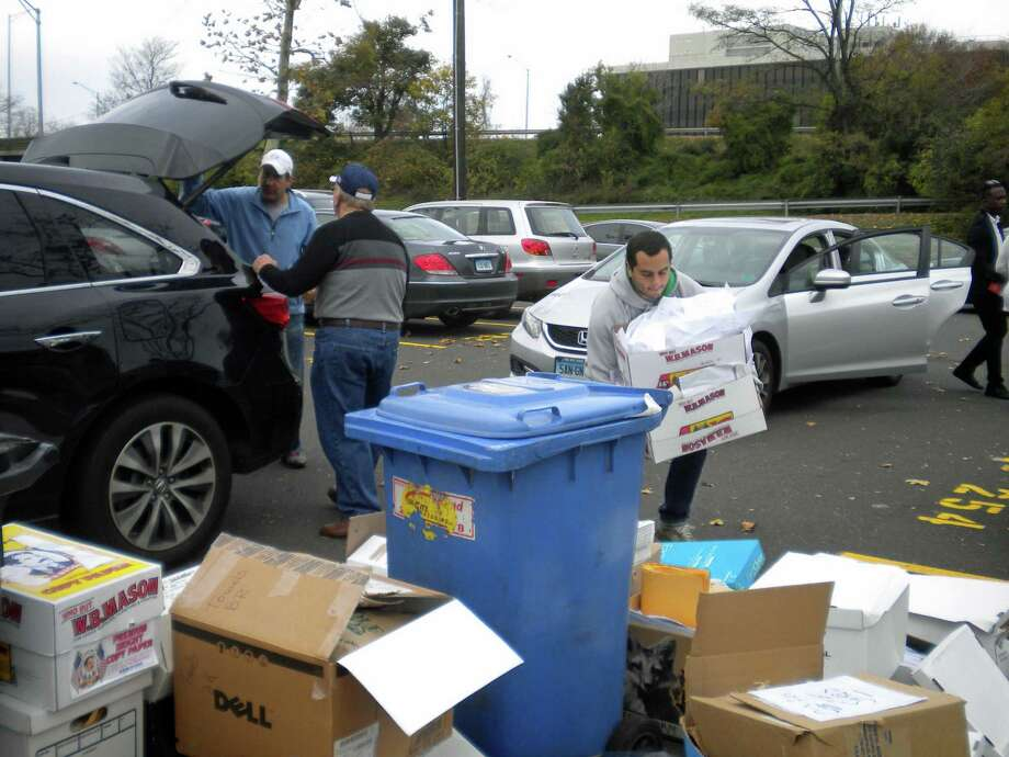 Some 500 cars brought personal documents and other papers to the recent paper shredding event held at Island Beach parking lot, enough material to fill three trucks in less than three hours. A record 12.38 tons of paper was recycled during this twice-a-year event, the equivalent of 210 trees, and 15 cases of canned goods were donated to Neighbor to Neighbor. Sponsors were The First Bank of Greenwich and Santaguida Sanitation, the Greenwich Recycling Advisory Board and Greenwich Green & Clean. Photo: Contributed/Sally Davies / Contributed Photo / Greenwich Time Contributed