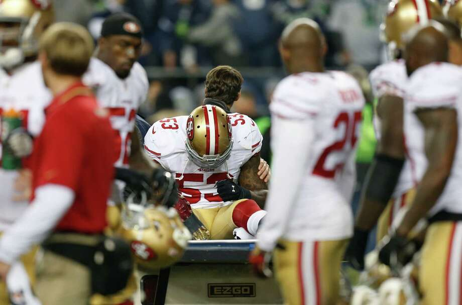 NaVorro Bowman is carted off the field during the NFC Championship Game in January 2014. Photo: Michael Macor / The Chronicle / ONLINE_YES