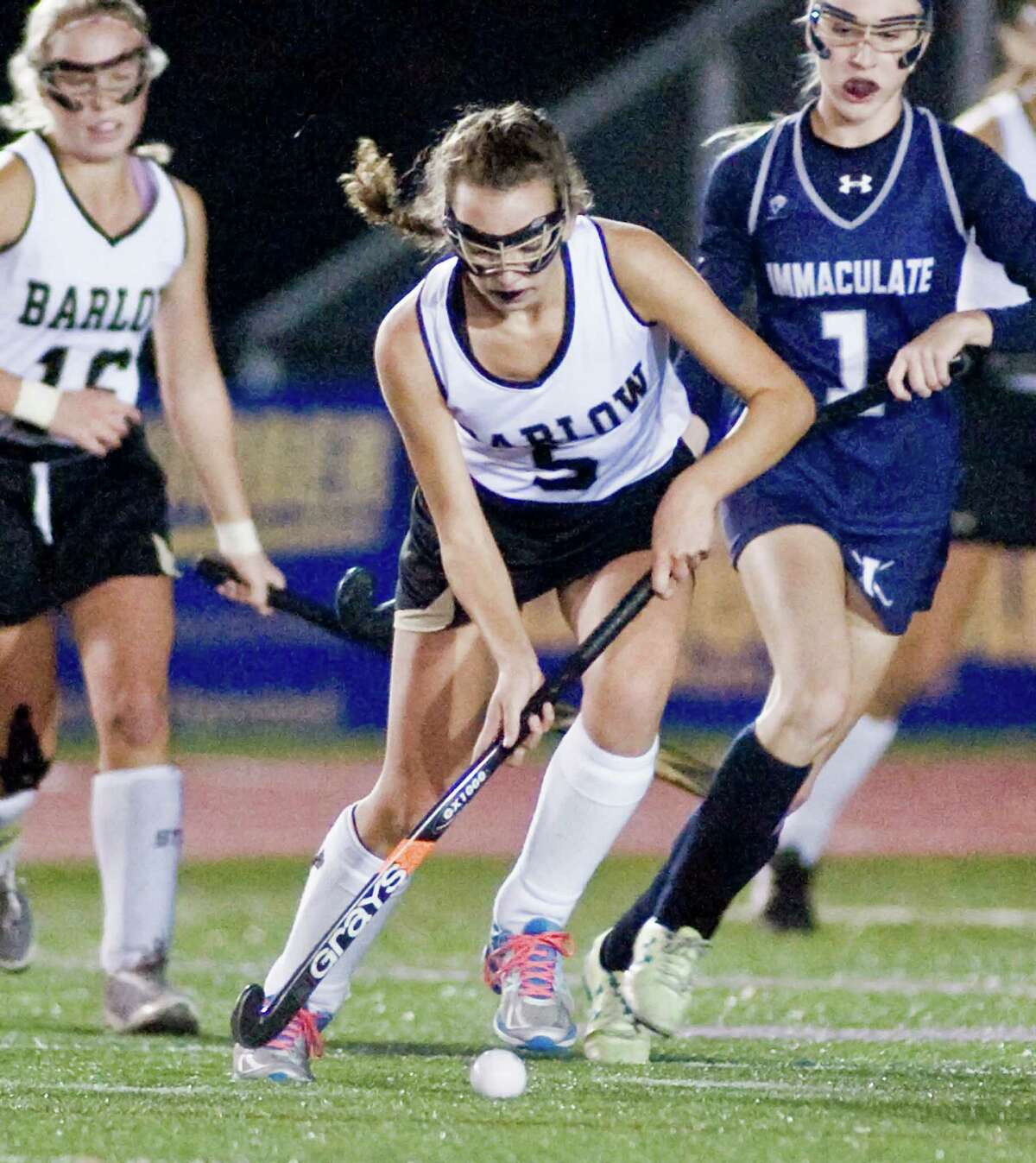 Joel Barlow High School's Gloria Davey pushes the ball in the SWC field hockey championship game against Immaculate High School, played at Brookfield High School. Wednesday, Nov. 4, 2015