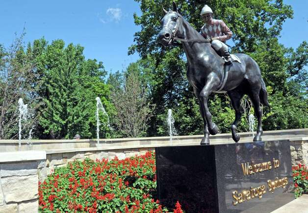 """The """"Native Dancer"""" statuewasunveiled at Congress Park's Centennial Park on Saturday Aug. 1, 2015 in Saratoga Springs, N.Y. The statue was donated by by MaryLou Whitney and John Hendrickson and created by equine artist Gwen Reardon. (Michael P. Farrell/Times Union) Photo: Michael P. Farrell / 10032851A"""