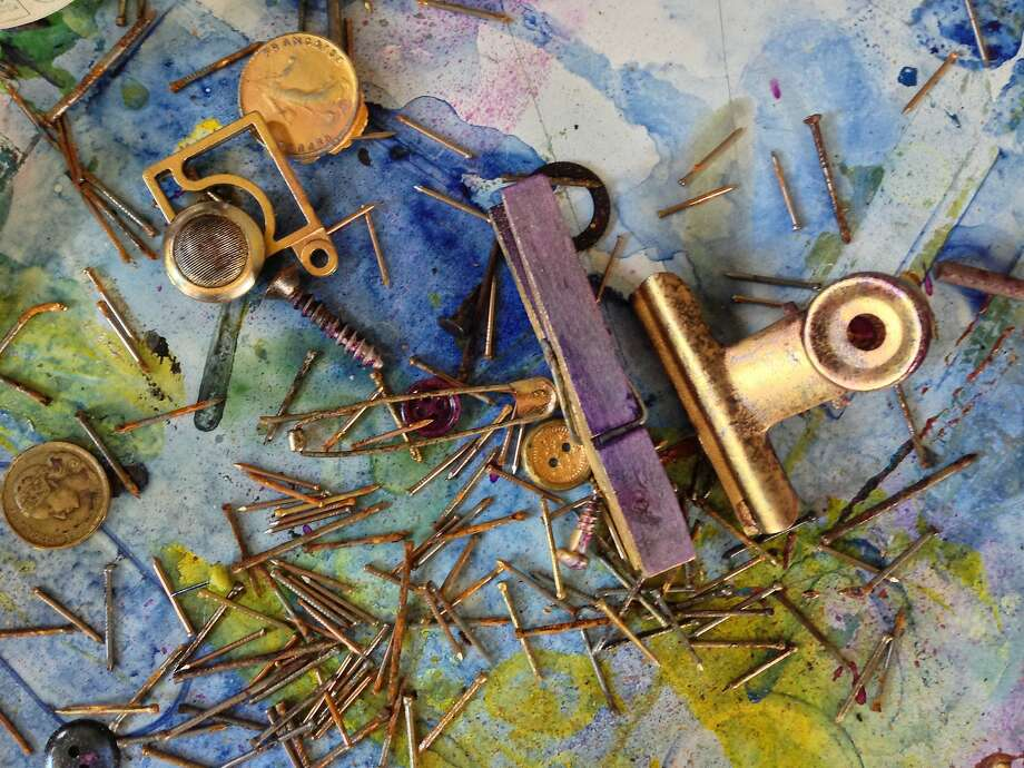 """An assortment of tools that Everett found in a studio in Toulouse, France, that belonged to his father-in-law, Bruno Tollon, served as the subject matter for """"Inutile."""" The drawings were made with ink, alcohol, salt and graphite.  """"The images were generated by laying down random groups of tools and various discarded instruments of labor such as rusted nails, paper clips, magnets, clamps or rulers, and then applying ink washes either by hand or spray,"""" says Everett. He says the tools included some that had not been used in over 100 years as well as others that date back to the 16th century. Photo: RITE Editions"""