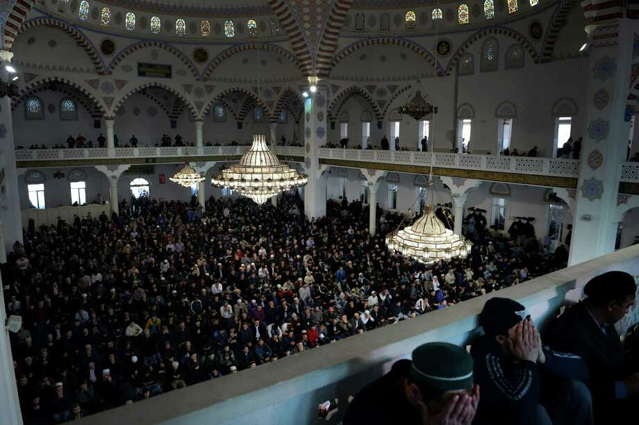 Muslims pray in a mosque frequented by Salafis, ultraconservative Islamists whose strict interpretation of religious texts has inspired extremism, in Makhachkala, the capital of Dagestan, Russia's southernmost republic.  Photo: JAMES HILL, STR / NYTNS