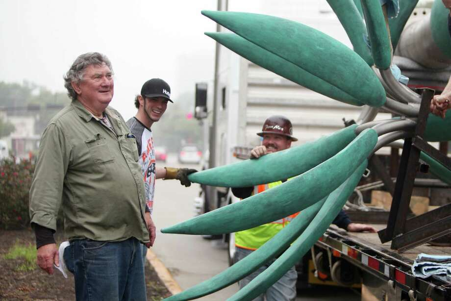 "Surls in 2014 with ""Tree and Three Flowers"" as it's prepared to be installed in the median on Kirby Drive near Westheimer. Photo: Mayra Beltran, Staff / © 2014 Houston Chronicle"