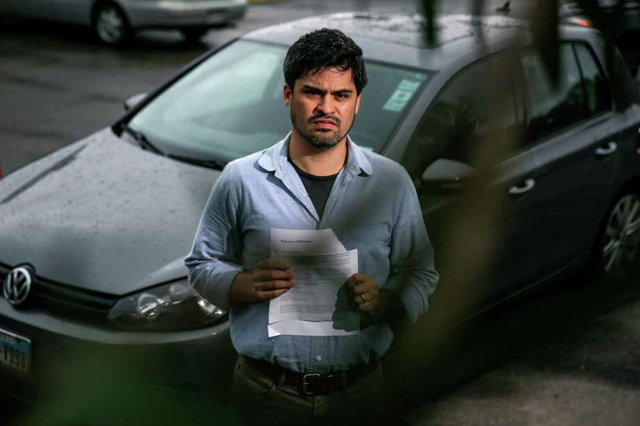 Dr. Ricardo Nuila said he feels duped by Volkswagen after being notified his 2011 Golf was part of the scandal. Photo: Michael Ciaglo, Staff / © 2015  Houston Chronicle