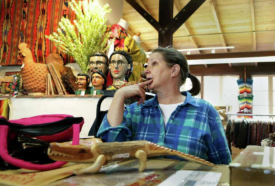 Chris Van Wyk, owner of Village Weavers in La Villita, moves out of her shop   where she conducted business for more than 20 years.   Photo: Bob Owen /San Antonio Express-News / San Antonio Express-News