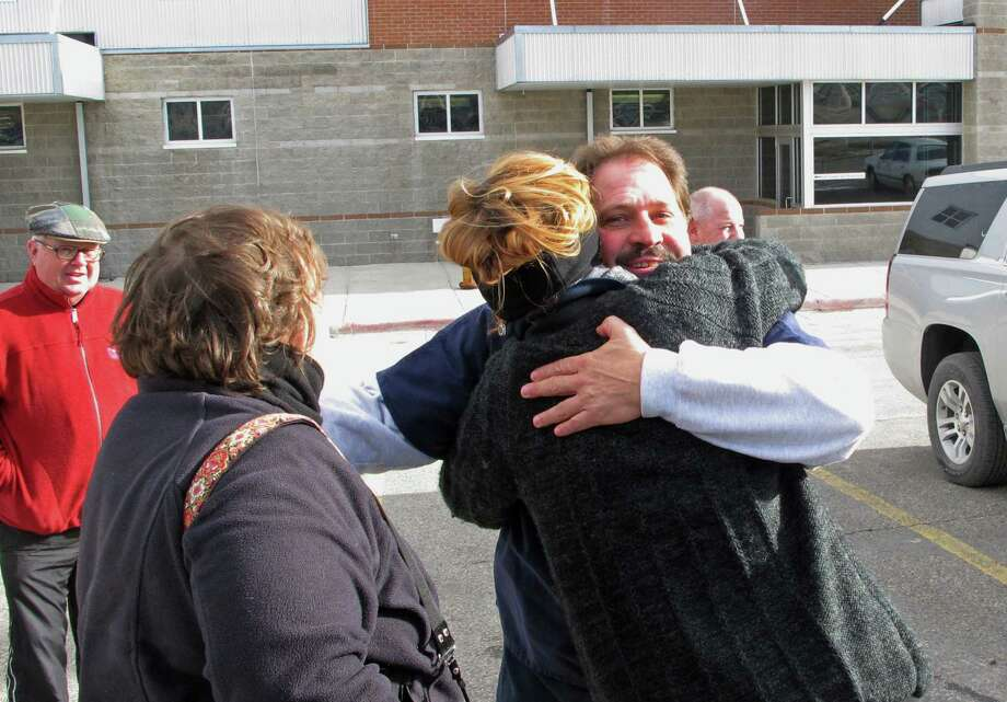 Barry Beach hugs a reporter as he departs Montana State Prison in Deer Lodge, Mont., on Friday after his prison sentence was commuted by the governor.  Photo: Matt Volz, STF / AP