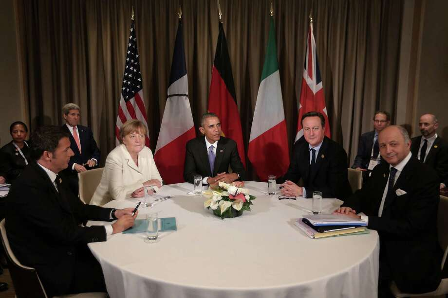 Italian (L-R) Prime Minister Matteo Renzi, Germany's Chancellor Angela Merkel, U.S President Barack Obama, British Prime Minister David Cameron and French Minister of Foreign Affairs and International Development Laurent Fabius talk during a round table meeting on day two of the G20 Turkey Leaders Summit on Nov.16, 2015 in Antalya, Turkey.   (Photo by Chris McGrath/Getty Images) Photo: Chris McGrath, Staff / 2015 Getty Images