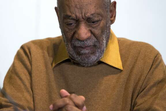 FILE - In this Nov. 6, 2014 file photo, entertainer Bill Cosby pauses during a news conference.  Cosby's lawyers were expected to file a response Friday, Nov. 13, 2015,  to a defamation lawsuit filed last year in federal court in Massachusetts. Instead, a lawyer for three women already named as plaintiffs in the lawsuit filed a notice in court saying four new plaintiffs will be added. The amended suit is expected to be filed later Friday. (AP Photo/Evan Vucci, File)