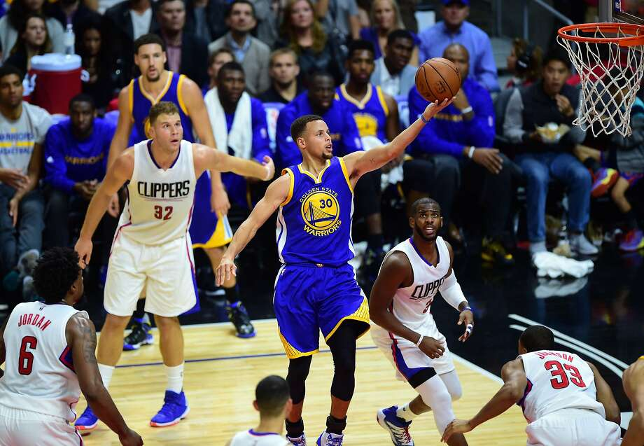 The Clippers tried to surround Warriors point guard Stephen Curry on Thursday, but he still soared to the forefront in Golden State's win in Los Angeles. Photo: Frederic J. Brown, AFP / Getty Images