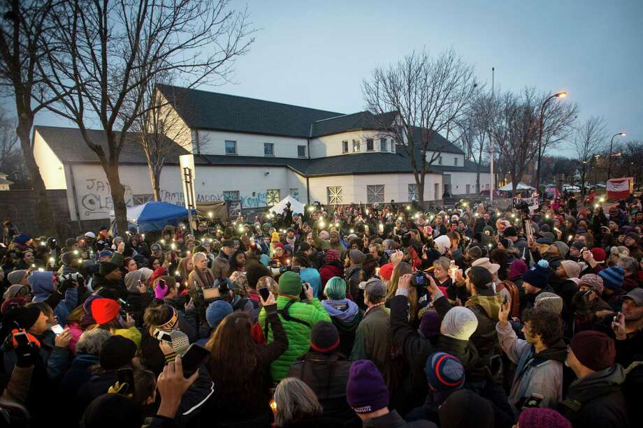 People participate in a candlelight vigil Friday outside the Minneapolis Police Department 4th precinct building. The vigil was in response to the shooting death of Jamar Clark by police on Sunday. Photo: Aaron Lavinsky, MBO / Star Tribune