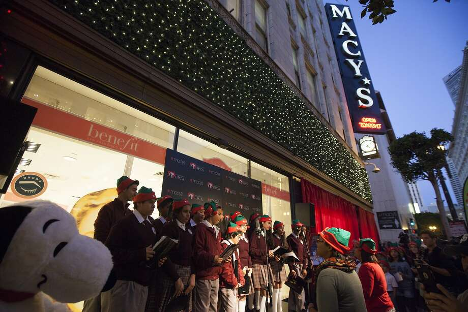 Students of the De Marillac Academy sing before the window display unveiling at Macy's, Friday, Nov. 20, 2015, in San Francisco, Calif. Macy's unveiled at their display windows puppies and kittens available for adoption. Photo: Santiago Mejia, Special To The Chronicle
