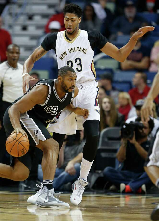 San Antonio Spurs center Boris Diaw (33) drives against New Orleans Pelicans forward Anthony Davis (23) during the first half of an NBA basketball game in New Orleans, Friday, Nov. 20, 2015. (AP Photo/Max Becherer) Photo: Max Becherer, Associated Press / FR171354 AP