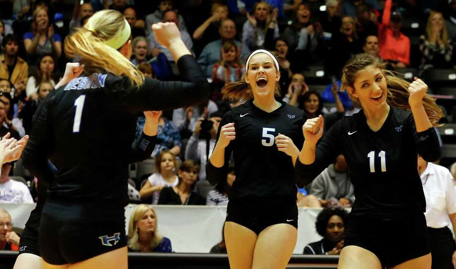 Hebron's Kendall Patterson (1), Jordan Yauch (5) and Savy Blagg (11) celebrate a point against  New Braunfels  Canyon during their Class 6A state semifinal volleyball match in Garland Texas, Friday, November 20, 2015. Hebron defeated New Braunfels Canyon 3-0. Mike Stone/Special Contributor  to The Dallas Morning News Photo: Mike Stone / Special Contributor / 20027662A
