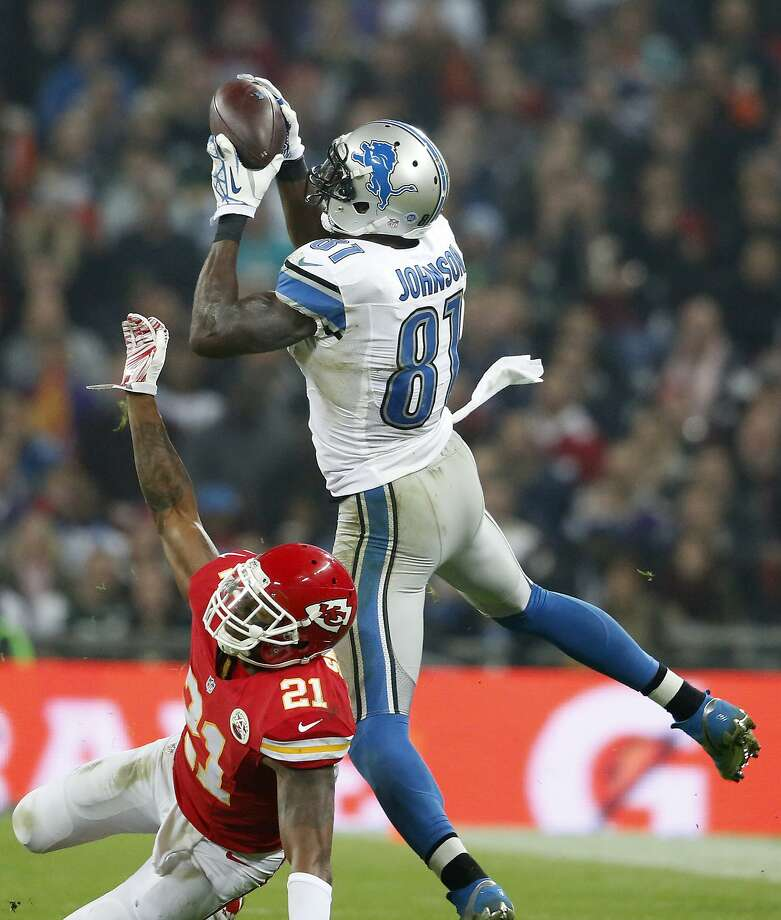 "Calvin ""Megatron"" Johnson of the Detroit Lions, catches a pass here against the Kansas City Chiefs. Johnson, Detroit's top receiver, has only one 100-yard game this season — down from five last season — but he is 11th in the NFL with 740 re ceiving yards. Photo: Alan Crowhurst, Getty Images"