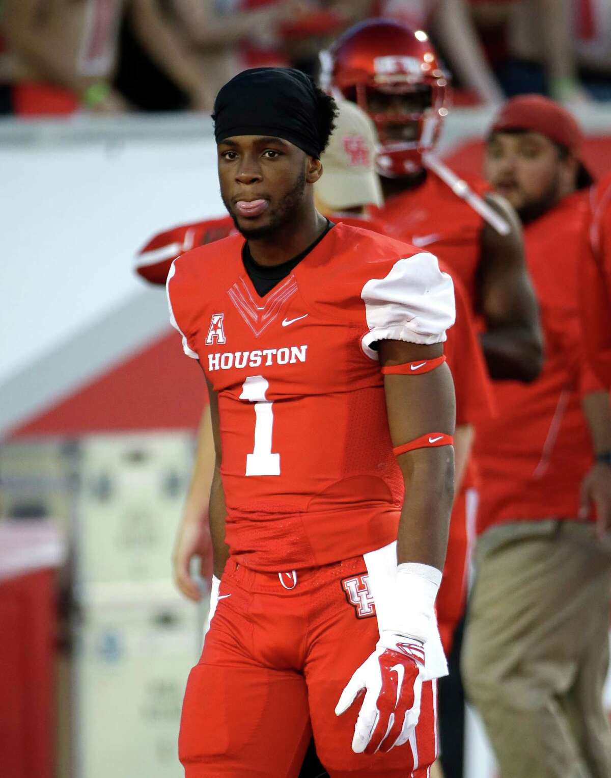 Houston quarterback Greg Ward Jr. (1) warms up before an NCAA college football game against Memphis Saturday, Nov. 14, 2015, in Houston. (AP Photo/David J. Phillip)