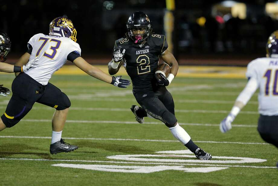 Antioch's Najee Harris, 2 on a first quarter run as the Antioch Panthers take on the Amador Valley Dons in Antioch, Calif., on Fri. November 20, 2015. Photo: Michael Macor, The Chronicle