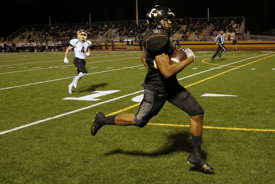 Ryan Pane, here scoring a touchdown in Antioch's 58-21 quarterfinal defeat of Amador Valley last Friday, will try to keep Panthers unbeaten as they play Foothill in one a North Coast Section Division I semifinal on Saturday. Photo: Michael Macor, The Chronicle