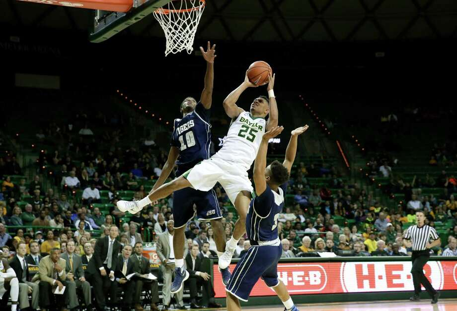 Baylor sophomore guard Al Freeman (25) splits Jackson State defenders Raeford Worsham and Yettra Specks for two of his game-high 20 points. Photo: Tony Gutierrez, STF / AP